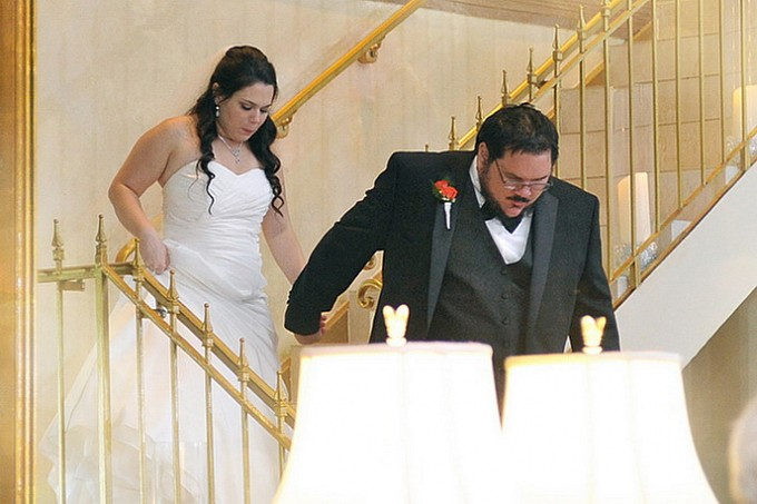bride & groom down the staircase