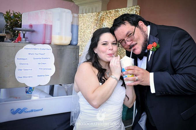 bride and groom eat snoballs